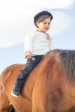 Child with a horse. Royalty Free Stock Photography