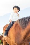 Child with a horse. Stock Images