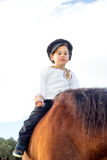 Child with a horse. Stock Photo