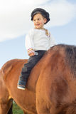 Child with a horse. Royalty Free Stock Photos