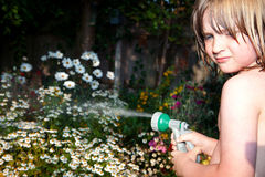 Child hosepipe water summer garden splash Stock Photo