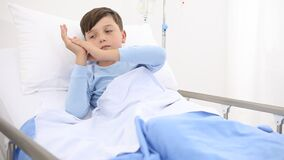 Child in hospital falls asleep lying alone in bed