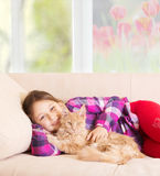 Child hugging cat Royalty Free Stock Image