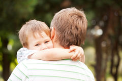 Child hugging daddy. Happy father and son outdoors. Child hugging daddy royalty free stock photos