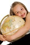 Child hugging a globe Stock Image