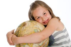Child hugging a globe Royalty Free Stock Image
