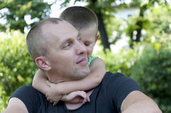 Child hugging his father Royalty Free Stock Images