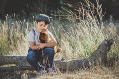 Child hugging his teddy bear