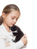 Child hugging a kitten Stock Images