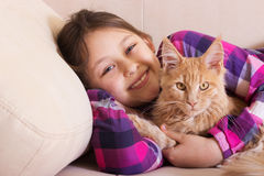 Child hugging a kitten Royalty Free Stock Photo