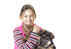 Child hugging a kitten and puppy Stock Photography