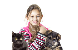 Child hugging a kitten and puppy Stock Images