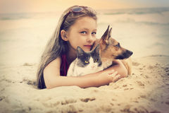 Child hugging pets stock image