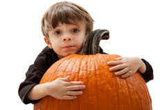 Child Hugging Pumpkin Stock Photos