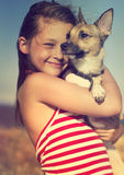 Child hugging a puppy Royalty Free Stock Images
