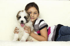 Child hugging a puppy Royalty Free Stock Photo