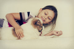 Child hugging a puppy Stock Photo