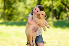 Child is hugging a puppy stock images