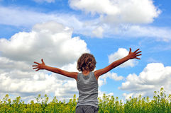 Child hugging the sky Royalty Free Stock Photos