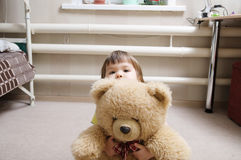 Child hugging teddy bear, devotion concept, kid hiding behind the toy Royalty Free Stock Image