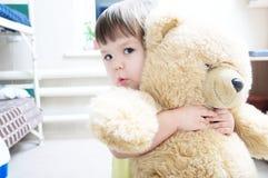 Child hugging teddy bear Royalty Free Stock Photo