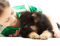 Child   hugs puppy Stock Image