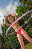Child with hula hoop Royalty Free Stock Photography