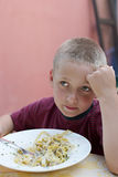 Child hungry. Adorable child hungry at the time of eating Stock Photography