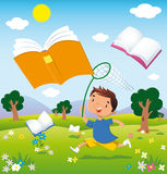 Child on the hunt for books. A child running through the fields in bloom chasing flying books Stock Photography