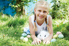 Child hunted on Easter egg in blooming spring garden. stock photos