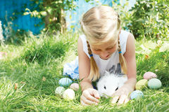 Child hunted on Easter egg in blooming spring garden. stock photography
