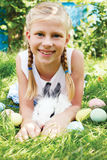 Child hunted on Easter egg  in blooming spring garden. Stock Images