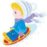 Child on an ice-boat Royalty Free Stock Photo