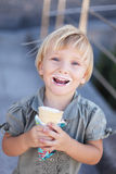 Child and ice cream. Baby girl eating a ice cream in wafer cup Stock Photography
