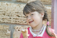 The child and ice-cream Stock Image