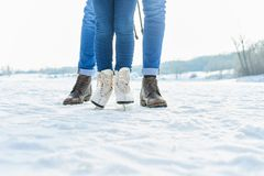 Child ice-skates with father in winter royalty free stock photography