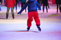 Child ice skating at night in Vienna, Austria. Winter. Stock Photography