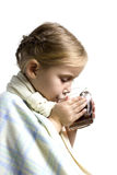 Child is ill with cup of tea Royalty Free Stock Photos