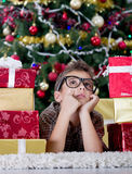 Child imagines what he received from gifts on Christmas night Royalty Free Stock Photos