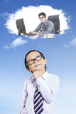Child imagining a businessman Royalty Free Stock Photos