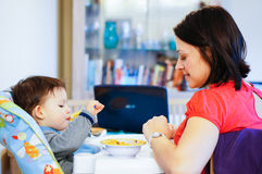 Child In Feeding Chair Royalty Free Stock Photography