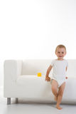 Child In Front Of Couch/sofa Stock Image