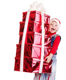 Child In Santa Hat With Stack Gift Box.