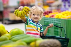 Free Child In Supermarket. Kid Grocery Shopping Royalty Free Stock Photo - 161172765