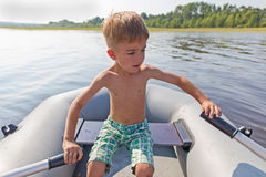 Child in an inflatable boat for rowing Stock Photo
