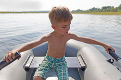 Child in an inflatable boat for rowing Royalty Free Stock Photo