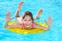 Child  on inflatable ring . Stock Photo