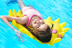 Child  on inflatable ring . Stock Photos