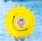 Child  on inflatable ring . Royalty Free Stock Image