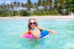 Child on tropical beach. Sea vacation with kids. Royalty Free Stock Image